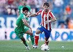 Atletico de Madrid's Diego Ribas against Racing de Santander's Lautaro Acosta during La Liga Match. September 18, 2011. (ALTERPHOTOS/Alvaro Hernandez)