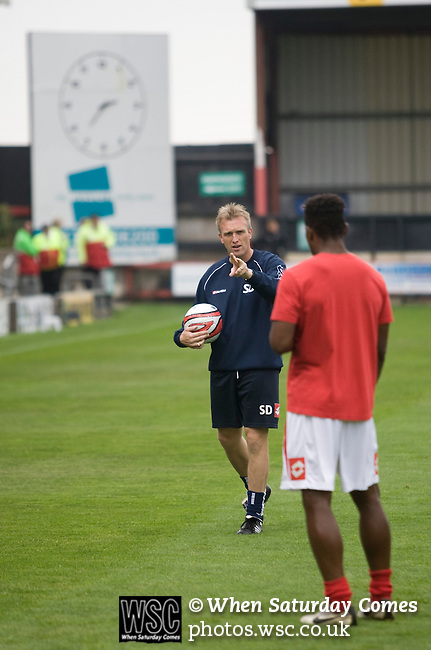 Crewe Alexandra assistant manager Steve Davis giving instructions to one of his Crewe Alexandra players as they warm up prior to their League 2 fixture against Aldershot Town at the Alexandra Stadium. The visitors won by 2 goals to 1.