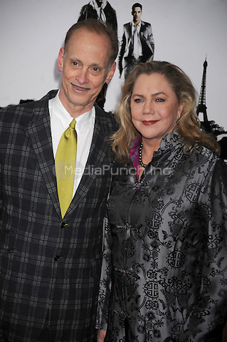John Waters and Kathleen Turner attend the 'From Paris With Love' premiere at the Ziegfeld Theatre  in New York City. January 28, 2010. Credit: Dennis Van Tine/MediaPunch