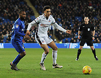 Bolton Wanderers' Antonee Robinson under pressure from Cardiff City's Junior Hoilett<br /> <br /> Photographer Kevin Barnes/CameraSport<br /> <br /> The EFL Sky Bet Championship - Cardiff City v Bolton Wanderers - Tuesday 13th February 2018 - Cardiff City Stadium - Cardiff<br /> <br /> World Copyright &copy; 2018 CameraSport. All rights reserved. 43 Linden Ave. Countesthorpe. Leicester. England. LE8 5PG - Tel: +44 (0) 116 277 4147 - admin@camerasport.com - www.camerasport.com