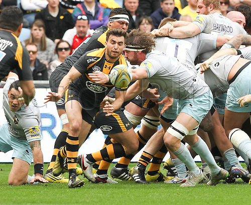 2016 Rugby Aviva Premiership Wasps v Northampton Saints Apr 3rd.  Saints fly angerbase of a scrum and captain Tom Wood attempts tp prevent Wasps scrum-half Craig Hampson from passing out from the base of the scrum.