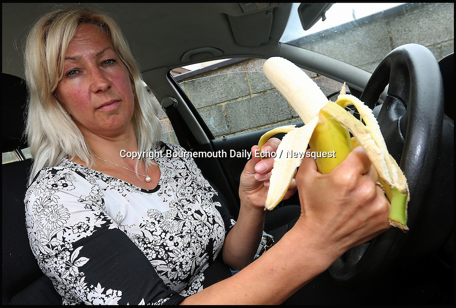 BNPS.co.uk (01202 558833)<br /> Pic: SallyAdams/BNPS<br /> <br /> Keep 'em peeled...<br /> <br /> A motorist was astonished when a policeman pulled her over and fined her £100 - for eating a banana in a traffic jam.<br /> <br /> Elsa Harris, 45, had already half-peeled the fruit before she set off to work but took the chance to lower a piece of skin further while her car was stationary.<br /> <br /> Moments later a police officer stopped her in Christchurch, Dorset, for not being control of her vehicle.