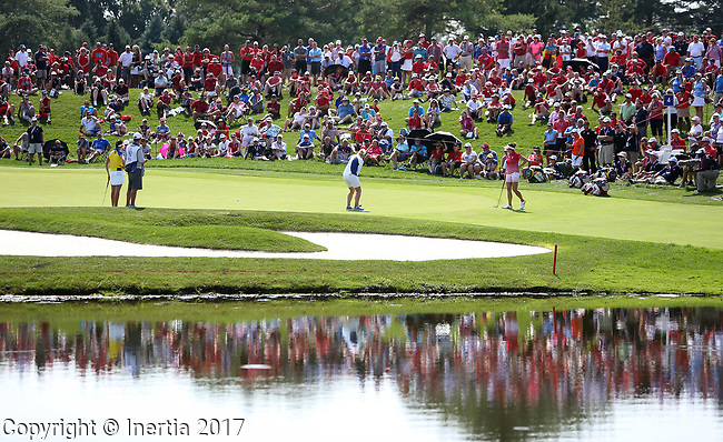 DES MOINES, IA - AUGUST 18: A large crowd watches Europe's Charley Hull roll her birdie putt on the 4th hole during her afternoon match at the 2017 Solheim Cup in Des Moines, IA. (Photo by Dave Eggen/Inertia)