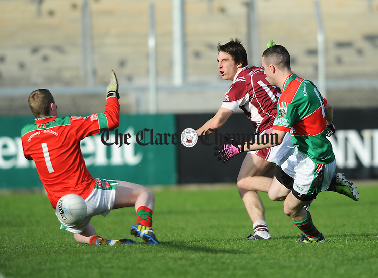 Cathal Duggan of Doora Barefield in action against Peter O Dwyer and Shane Hickey of Kilmurry Ibrickane during the senior county football final at Cusack park. Photograph by John Kelly.
