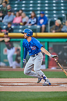 Chesny Young (9) of the Iowa Cubs follows through on his swing against the Salt Lake Bees in Pacific Coast League action at Smith's Ballpark on May 13, 2017 in Salt Lake City, Utah. Salt Lake defeated Iowa  5-4. (Stephen Smith/Four Seam Images)