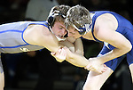 SIOUX FALLS, SD: DECEMBER 8: Ben Gillette from South Dakota State battles with Blake Jans from Augustana in their 133 pound match Sunday afternoon at the Sanford Pentagon. (photo by Dave Eggen/Inertia)