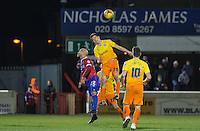 Luke O'Nien of Wycombe Wanderers beats Luke Gutteridge of Dagenham & Redbridge in the air during the Sky Bet League 2 match between Dagenham and Redbridge and Wycombe Wanderers at the London Borough of Barking and Dagenham Stadium, London, England on 9 February 2016. Photo by Andy Rowland.