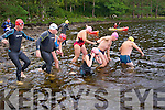 The swimmers take to the lake at the Dundag Masters 5km swim in Muckross Lake Killarney on Sunday