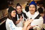 New York, NY - October 21, 2014: Mission Chinese Food's Executive Chef Angela Dimayuga (left), Del Posto Pastry Chef Brooks Headley and Mission Chinese Food's owner, Danny Bowien pose for a selfie at Headley's book release party in the Bon Appetit offices.<br /> <br /> CREDIT: Clay Williams for Edible Manhattan<br /> <br /> &copy; Clay Williams / claywilliamsphoto.com