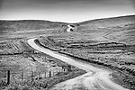 Narrow and winding country road in the green, rolling hills of western Kern County, Calif.<br /> <br /> <br /> San Andreas Rift Zone