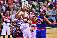 Otto Porter of the Wizards takes it to the rim against Knicks' defense.  New York defeated Washington 115-104 during a NBA preseason game at the Verizon Center in Washington, D.C. on Friday, October 9, 2015.  Alan P. Santos/DC Sports Box