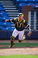 Michigan Wolverines catcher Harrison Wenson (7) retrieves the ball during the second game of a doubleheader against the Canisius College Golden Griffins on February 20, 2016 at Tradition Field in St. Lucie, Florida.  Michigan defeated Canisius 3-0.  (Mike Janes/Four Seam Images)