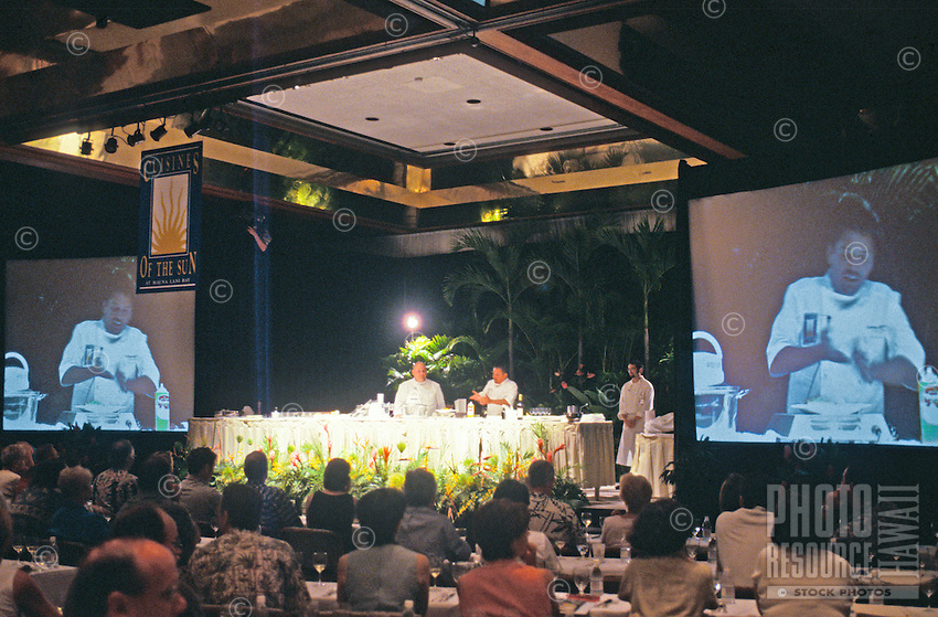Chefs demonstrate food preparation to an audience and are projected on large screens at the Cuisines of the Sun food festival at the Maunalani Bay Resort on the Big Island in July 2001