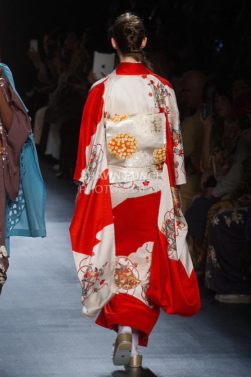 """Model walks runway in a """"Blooming"""" silk kimono from the Hiromi Asai Fall Winter 2016 """"Spirit of the Earth"""" collection by Hiromi Asai & Kimono Artisan Kyoto, presented at NYFW: The Shows Fall 2016, during New York Fashion Week Fall 2016."""