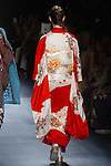 "Model walks runway in a ""Blooming"" silk kimono from the Hiromi Asai Fall Winter 2016 ""Spirit of the Earth"" collection by Hiromi Asai & Kimono Artisan Kyoto, presented at NYFW: The Shows Fall 2016, during New York Fashion Week Fall 2016."