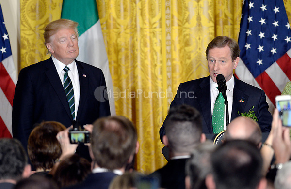 Prime Minister (Taoiseach) Enda Kenny of Ireland makes remarks as United States President Donald J. Trump looks on during a reception in the East Room of the White House in Washington, on March 16, 2017.<br /> Credit: Olivier Douliery / Pool via CNP /MediaPunch