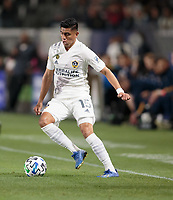 CARSON, CA - MARCH 07: Joe Corona #15 of the Los Angeles Galaxy moves with the ball during a game between Vancouver Whitecaps and Los Angeles Galaxy at Dignity Health Sports Park on March 07, 2020 in Carson, California.