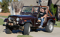 NWA Democrat-Gazette/DAVID GOTTSCHALK  Jason Kohrig sits with his dog Tuesday, November 1, 2016, in his favorite personal space, his classic jeep at his home in Fayetteville.