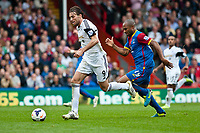 Sun 22 September 2013<br /> <br /> Pictured: Michu of Swansea takes the ball upfield<br /> <br /> Re: Barclays Premier League Crystal Palace FC  v Swansea City FC  at Selhurst Park, London