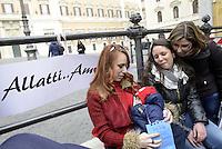 Roma, 18 Febbraio 2013.Piazza Montecitorio.Flash Mob avanti al Parlamento di mamme , donne e ostetriche per favorire la pratica di allattamento al seno anche in pubblico. Una mamma allatta al seno il figlio