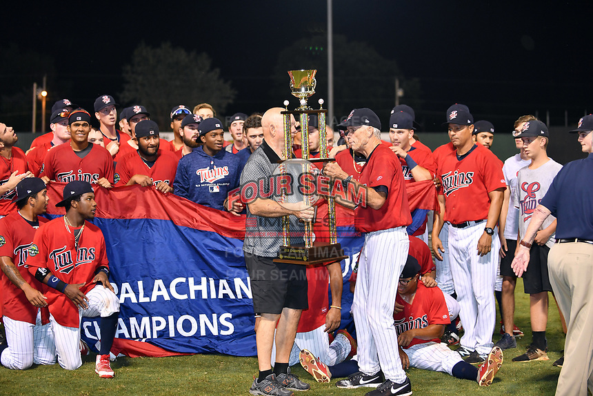 Elizabethton Twins manager Ray Smith (2) receives the championship trophy after winning the Appalachian League Championship Series against the Princeton Rays 2-1 at Joe O'Brien Field on September 5, 2018 in Elizabethton, Tennessee. (Tony Farlow/Four Seam Images)