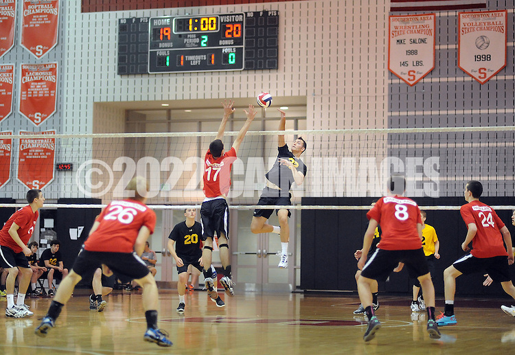 SOUDERTON, PA - MAY 31:  Central Bucks West's Christian Rupert #32 hits the ball over Parkland's Derrick Rice #17 during the PIAA Class AAA boys volleyball quarterfinal match May 31, 2014 at Souderton High School in Souderton, Pennsylvania. (Photo by William Thomas Cain/Cain Images)