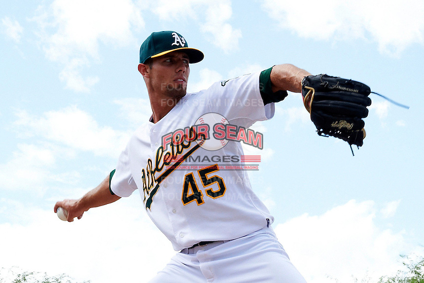 Oakland Athletics minor league pitcher Blake Hassebrock #45 warms up before an instructional league game against the Arizona Diamondbacks at the Papago Park Baseball Complex on October 11, 2012 in Phoenix, Arizona. (Mike Janes/Four Seam Images)