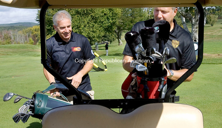 TORRINGTON CT. 28 September 2015-092815SV03-From left, Dave Vilardo and Charlie Carangelo of Waterbury PAL head out to play during the annual Torrington Police Activities League (PAL) golf tournament at Torrington Country Club in Torrington Monday. <br /> Steven Valenti Republican-American