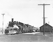 Westbound D&amp;RGW San Juan paused at Romeo depot - loading/unloading mail truck.<br /> D&amp;RGW  Romeo, CO  Taken by Perry, Otto C. - 5/8/1938