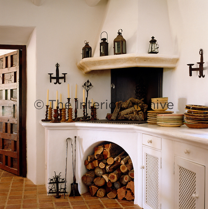 The former bread oven is now a feature of this whitewashed kitchen