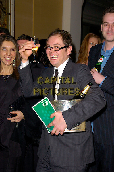 ALAN CARR.Inside Arrivals at the RTS Programme Awards, .Grosvenor House Hotel, Park Lane, London, England, March 13th 2007..half length bottle bucket glass drink of champagne.CAP/CAN.©Can Nguyen/Capital Pictures