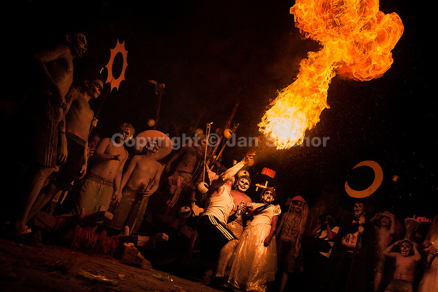 A young Salvadoran man spits fire as he performs during the La Calabiuza parade at the Day of the dead celebration in Tonacatepeque, El Salvador, 1 November 2016. The festival, known as La Calabiuza since the 90s of the last century, joins Salvador's pre-Hispanic heritage and the mythological figures (La Sihuanaba, El Cipitío, La Llorona etc.) collected from the whole Central American region, together with the catholic All Saints Day holiday and its tradition of honoring the dead relatives. Children and youths only, dressed up in scary costumes and carrying painted carts, march from the local cemetery to the downtown plaza where the party culminates with music, dance, drinking and eating pumpkin (Ayote) with honey.
