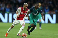 Perr Schuurs of Ajax and Victor Wanyama of Tottenham Hotspur during AFC Ajax vs Tottenham Hotspur, UEFA Champions League Football at the Johan Cruyff Arena on 8th May 2019