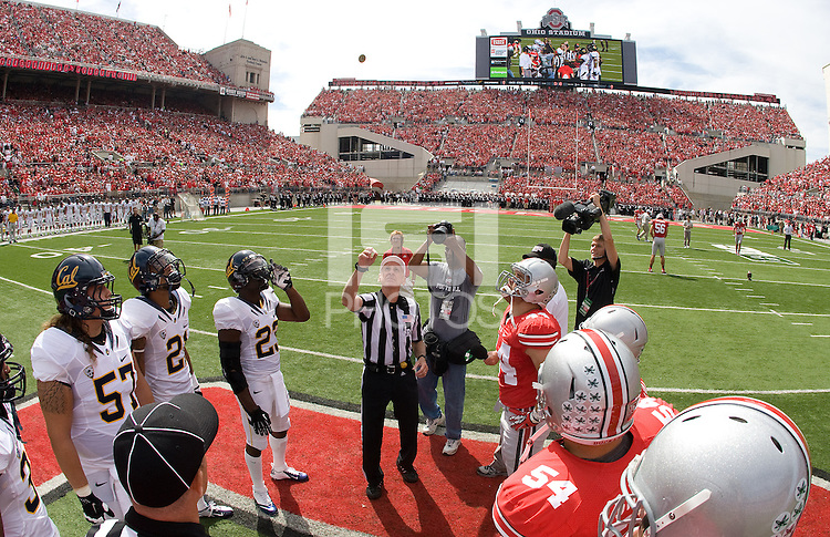 California captains' Robert Mullins, Brian Schwenke, Keenan Allen  and Josh Hill along with Ohio State captains watch referee Bill LeMonnier toss a coin before the game at Ohio Stadium in Columbus, Ohio on September 15th, 2012.   Ohio State Buckeyes defeated California Bears, 35-28.