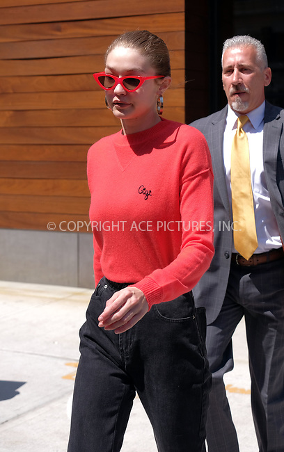 www.acepixs.com<br /> <br /> May 31 2017, New York City<br /> <br /> Model Gigi Hadid wears a personalised red sweater and matching sunglasses as she leaves her East Village apartment on May 31 2017 in New York City<br /> <br /> By Line: Curtis Means/ACE Pictures<br /> <br /> <br /> ACE Pictures Inc<br /> Tel: 6467670430<br /> Email: info@acepixs.com<br /> www.acepixs.com