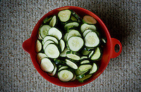 Sliced cucumbers fill a bowl and wait to be canned and pickled during a canning class at the home of Wall Street Journal reporter Ana Campoy (cq) in Dallas, Texas, USA, Saturday, Sept. 12, 2009. Growing produce or buying locally grown vegetables and canning at home is a fun and healthy way to keep grocery costs down...CREDIT: Matt Nager for The Wall Street Journal
