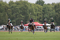 Marcos Di Paola (King Power) leads the attack on the ball during the Cartier Queens Cup Final match between King Power Foxes and Dubai Polo Team at the Guards Polo Club, Smith's Lawn, Windsor, England on 14 June 2015. Photo by Andy Rowland.