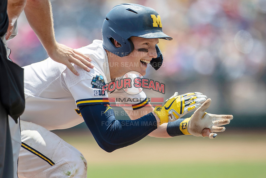 Michigan Wolverines shortstop Jack Blomgren (2) celebrates after reaching third base against the Texas Tech Red Raiders in the NCAA College World Series on June 21, 2019 at TD Ameritrade Park in Omaha, Nebraska. Michigan defeated Texas Tech 15-3 and will play in the CWS Finals. (Andrew Woolley/Four Seam Images)