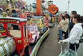 Children on a funfair ride in the Yorkshire seaside resort of Bridlington on Easter Bank Holiday.
