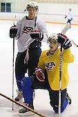 John Carlson (USA - 11), Chris Kreider (USA - 20) - Team USA practiced at the Agriplace rink on Monday, December 28, 2009, in Saskatoon, Saskatchewan, during the 2010 World Juniors tournament.