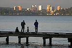 Bellevue, Seattle's neighboring city across Lake Washington, family and friends fishing, sunset, Mount Baker neighborhood, Seattle, Washington State, Pacific Northwest, USA.