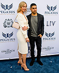 HALLANDALE BEACH, FL - JANUARY 27: Belinda Stronach and Wilmer Valderama on the Blue Carpet on Pegasus World Cup Invitational Day at Gulfstream Park Race Track on January 27, 2018 in Hallandale Beach, Florida. (Photo by Scott Serio/Eclipse Sportswire/Getty Images)