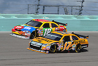 Nov. 15, 2008; Homestead, FL, USA; NASCAR Sprint Cup Series driver Matt Kenseth (17) races alongside Kyle Busch (18) during practice for the Ford 400 at Homestead Miami Speedway. Mandatory Credit: Mark J. Rebilas-