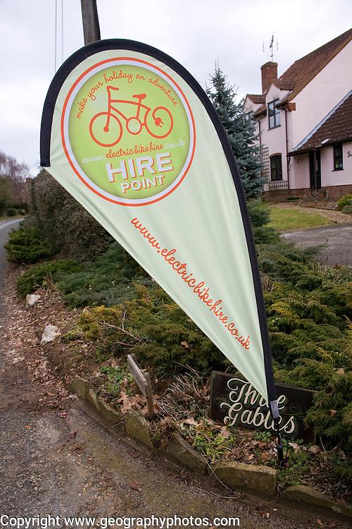 Electric bike hire point banner in house garden Shottisham, Suffolk, Banner for hire point for electric bike hire point