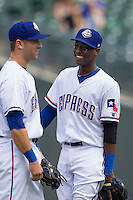 Round Rock Express shortstop Jurickson Profar #10 talks in between innings with teammate Mike Olt #20 during Pacific Coast League baseball game against the New Orleans Zephyrs in the  on April 21, 2013 at the Dell Diamond in Round Rock, Texas. Round Rock defeated New Orleans 7-1. (Andrew Woolley/Four Seam Images).