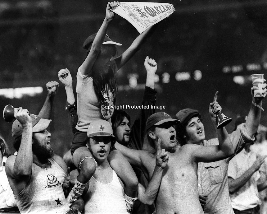 Oakland Athletics fans celebrate after World Series victory over the LA Dodgers in 1974. (photo by Ron Riesterer)
