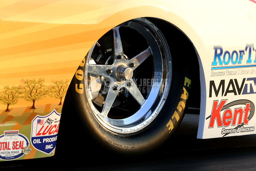 Feb 7, 2014; Pomona, CA, USA; Detailed view of the front wheel and tire of NHRA pro stock driver Rodger Brogdon during qualifying for the Winternationals at Auto Club Raceway at Pomona. Mandatory Credit: Mark J. Rebilas-