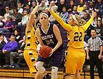 SIOUX FALLS, SD - DECEMBER 31: Moira Duffy #34 from the University of Sioux Falls eyes the basket between a pair of defenders including Lynsey Prosser #22 from Augustana University during their game Sunday afternoon December 31, 2017 at the Stewart Center in Sioux Falls. (Photo by Dave Eggen/Inertia)