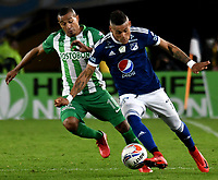BOGOTA - COLOMBIA - 18 – 02 - 2018: Ayron Del Valle (Der.) jugador de Millonarios disputa el balón con Macnelly Torres (Izq.) jugador de Atletico Nacional, durante partido de la fecha 4 entre Millonarios y por la Liga Aguila I 2018, jugado en el estadio Nemesio Camacho El Campin de la ciudad de Bogota. / Ayron Del Valle (R) player of Millonarios vies for the ball with Macnelly Torres (L) player of Atletico Nacional, during a match of the 4th date between Millonarios and Atletico Nacional, for the Liga Aguila I 2018 played at the Nemesio Camacho El Campin Stadium in Bogota city, Photo: VizzorImage / Luis Ramirez / Staff.