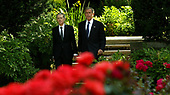 "Washington, D.C. - July 8, 2005 -- United States President George W. Bush and  Ambassador Sir David Manning  walk through the garden of the British embassy before President Bush layed a wreath in memory of those killed and injured during the bumbing attack. In earlier remarks the President stated: ""Yesterday was an incredibly sad day for a lot of families in London.  It's my honor, Ambassador, to come and represent our great country in extending our condolences to the -- to the people of Great Britain.  To those who suffer loss of life, we pray for God's blessings.  For those who are injured, we pray for fast healing.  The British people are steadfast and strong.  Long we've admired the great spirit of the -- of Londoners and the people of Great Britain.  Once again that great strength of character is coming through.""<br /> Credit: Dennis Brack - Pool via CNP"